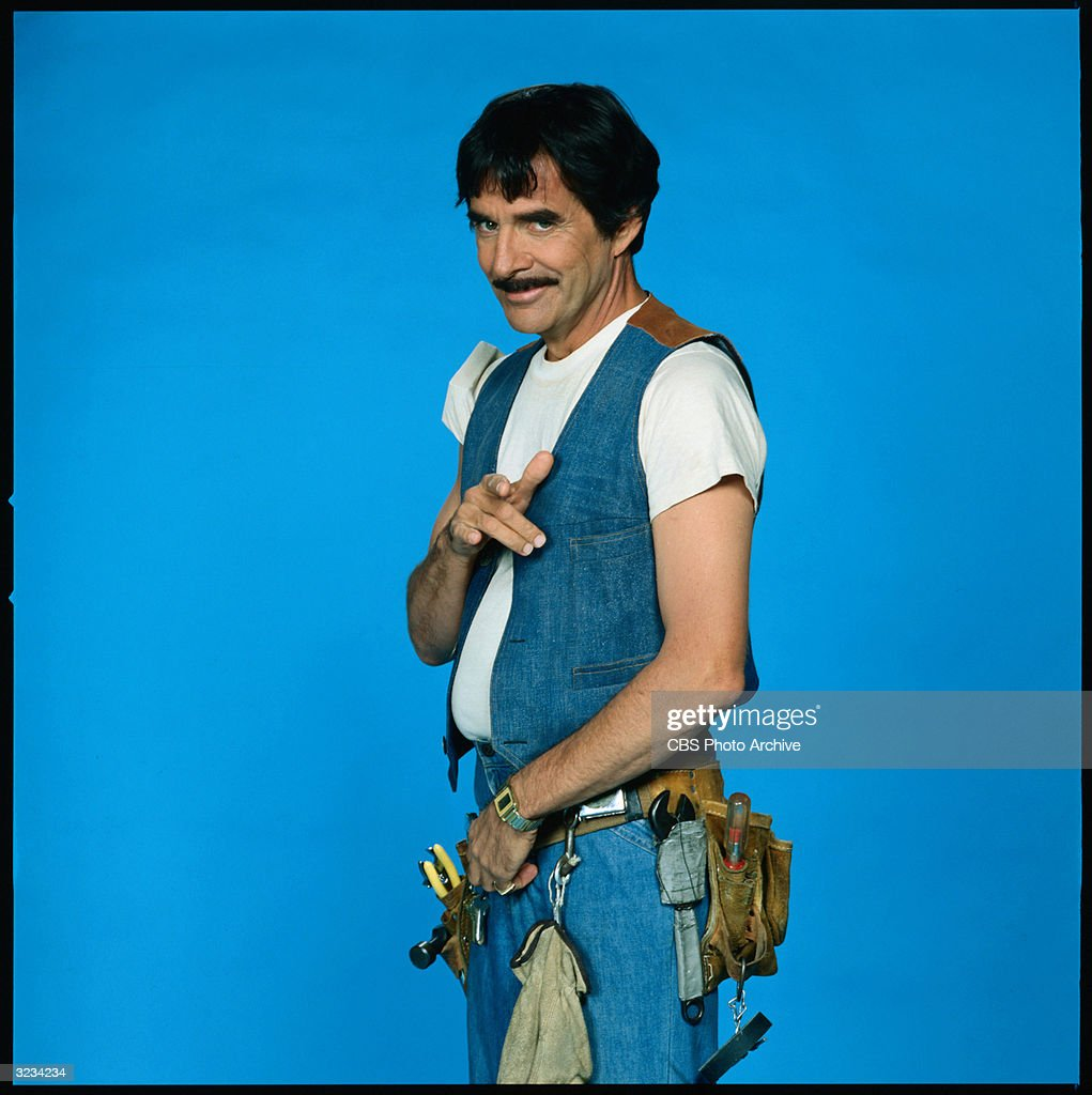 Promotional studio portrait of American actor Pat Harrington, Jr. wearing a denim vest, white T-shirt and a tool belt, in his role as building superintendent Dwayne Schneider from the TV series, 'One Day At A Time,' 1976.
