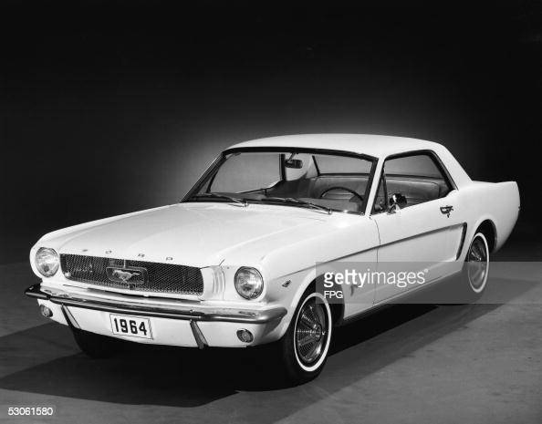 Promotional studio shot of a 1964 Ford Mustang 1964 This first series of the popular pony car is generally referred to as '1964 1/2 Mustangs' because...