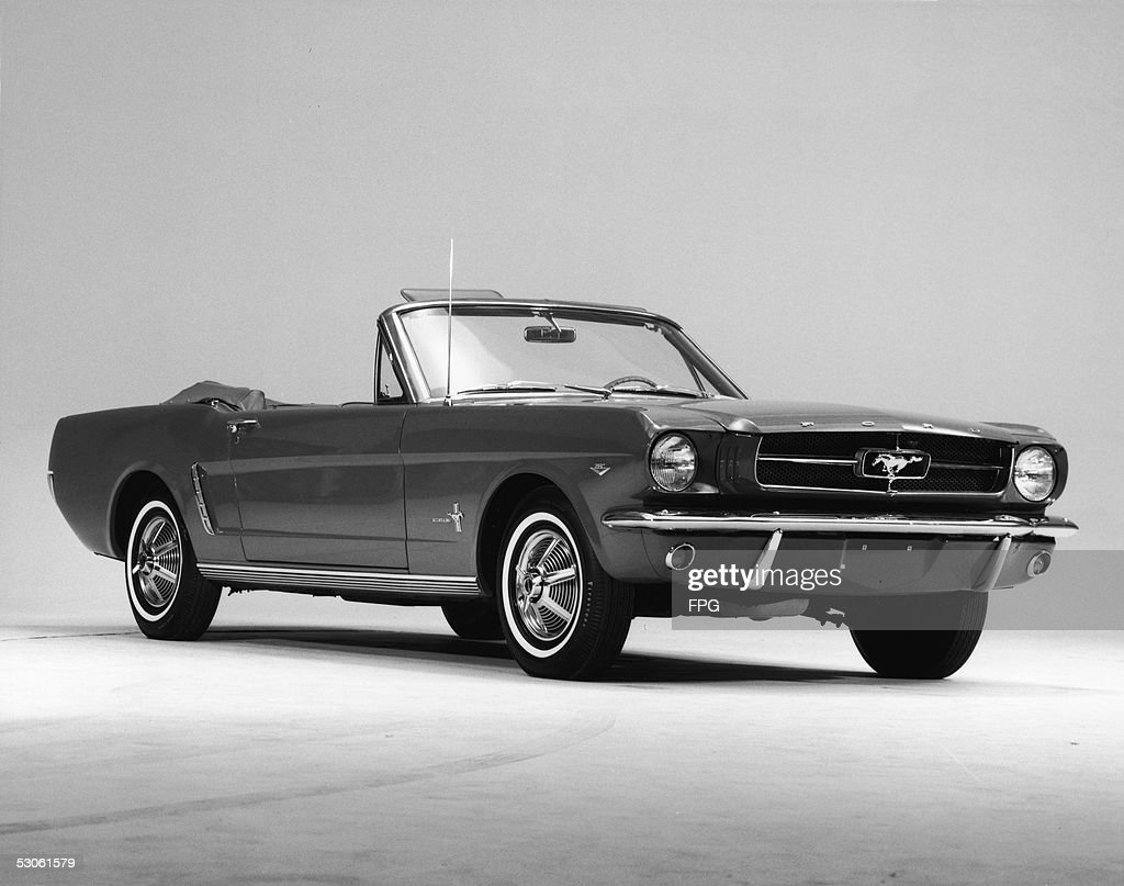 Promotional studio shot of a 1964 Ford Mustang convertible, 1964. This first series of the popular pony car is generally referred to as '1964 1/2 Mustangs,' because they were not rolled out in October of 1963 with the rest of the new 1964 Ford cars.