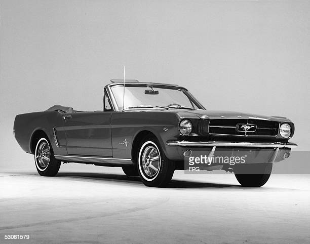 Promotional studio shot of a 1964 Ford Mustang convertible 1964 This first series of the popular pony car is generally referred to as '1964 1/2...