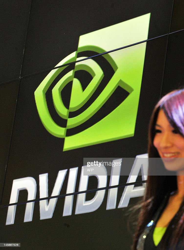 A promter stands in front of a NVIDIA logo during the 2012 Computex in Taipei on June 7, 2012. Computex is Asia's leading IT trade fair. AFP PHOTO / Mandy CHENG