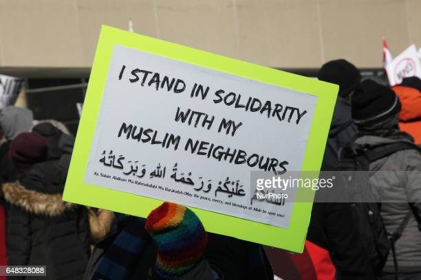 ProMuslim demonstrators hold a counterprotest against antiMuslim groups over the M103 motion to fight Islamophobia during proMuslim and antiMuslim...