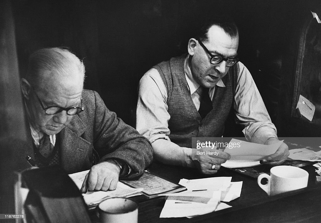 Proof-readers at work on a Saturday afternoon at the offices of the News of The World, April 1953. Original Publication : Picture Post - 6488 - The News of The World - pub. 18th April 1953.