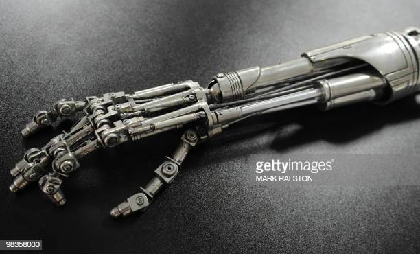 A prop endoskeleton arm from the movie 'Terminator 2 Judgement Day' that is estimated to sell for 12000 USD is on display with other movie...