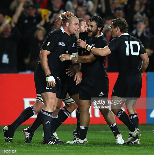 Prop Tony Woodcock of the All Blacks is congratulated by teammates Piri Weepu and Aaron Cruden after scoring the opening try during the 2011 IRB...