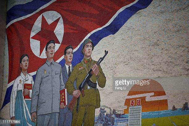 Propaganda mural painting is seen outside People¯s Palace of Culture on April 2 2011 in Pyongyang North Korea Pyongyang is the capital city of North...
