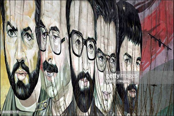 A propaganda mural shows martyrs killed in the war against Iraq