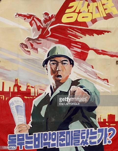 Propaganda poster in North Korea on April 20 2008