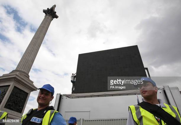 A proPalestine demonstrator scales the mobile television screen to demonstrate during the Salute to Israel Parade in Trafalgar square London UK