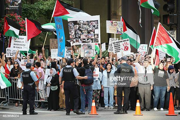 ProPalestine demonstrators protest across the street from a proIsrael rally on July 28 2014 in Chicago Illinois A heavy police presence kept the two...