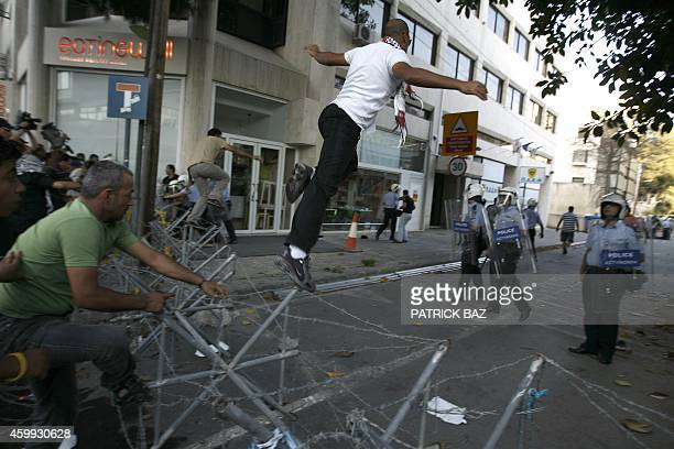 ProPalestinian activists break through the Cypriot police cordon surrounding the Israeli embassy in Nicosia on May 31 2010 during a protest against...