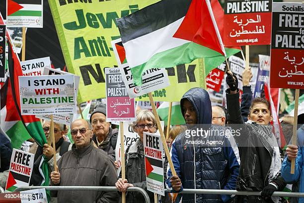 ProPalestinian activists gather outside the Israeli embassy in London England to protest Israeli aggression on Palestinians on October 17 2015