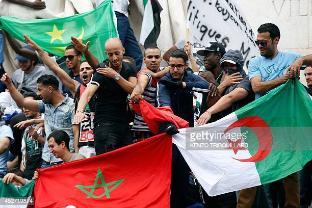 ProPalestinian demonstrators gesture the 'quenelle' sign on the Republique square in Paris during a banned demonstration against Israel's military...