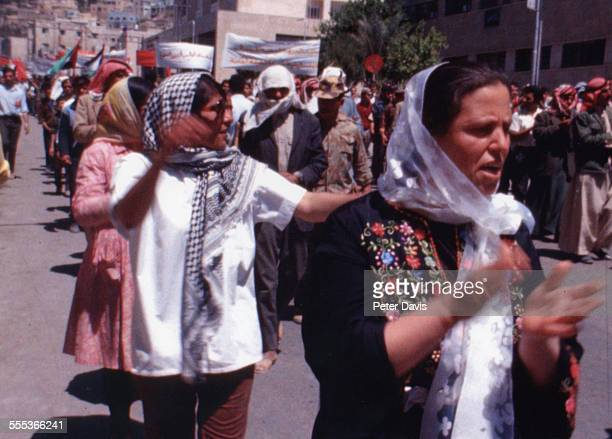 ProPalestinian demonstrators march along an unidentified street Amman Jordan mid September 1970 The demonstration occured during a series of ongoing...