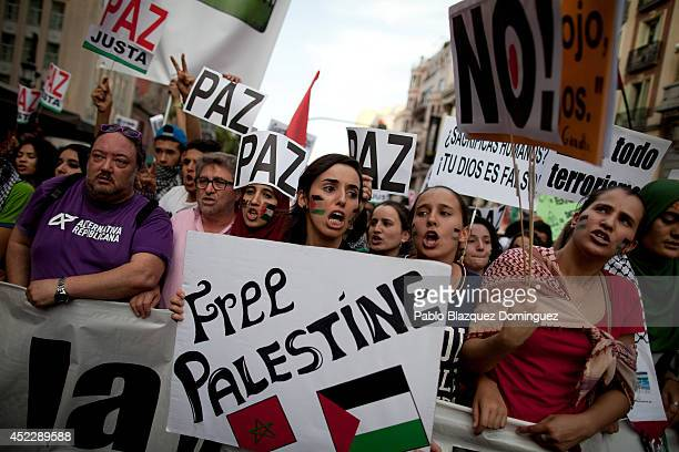 ProPalestinian demonstrators shout slogans and hold placards reading 'Peace' and 'Free Palestine' during a demonstration on July 17 2014 in Madrid...