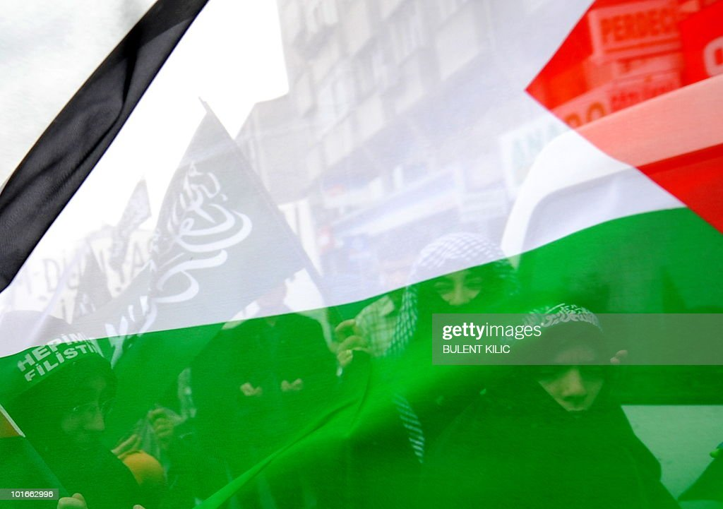 Pro-Palestinian demonstrators walk behind the Palestinian flag during a protest in Istanbul on June 6, 2010 against Israel's deadly raid on Gaza-bound aid ship. Some 1,000 people called on the government to expel Israeli diplomats in a demonstration in Umraniye on the city's Asian side called by a coalition of Islamist non-governmental organizations. Turkey's Prime Minister Recep Tayyip Erdogan vowed to hold Israel to account over its 'state terror' in the Middle East as thousands held fresh protests against the Israeli operation, in which nine Turks were killed.