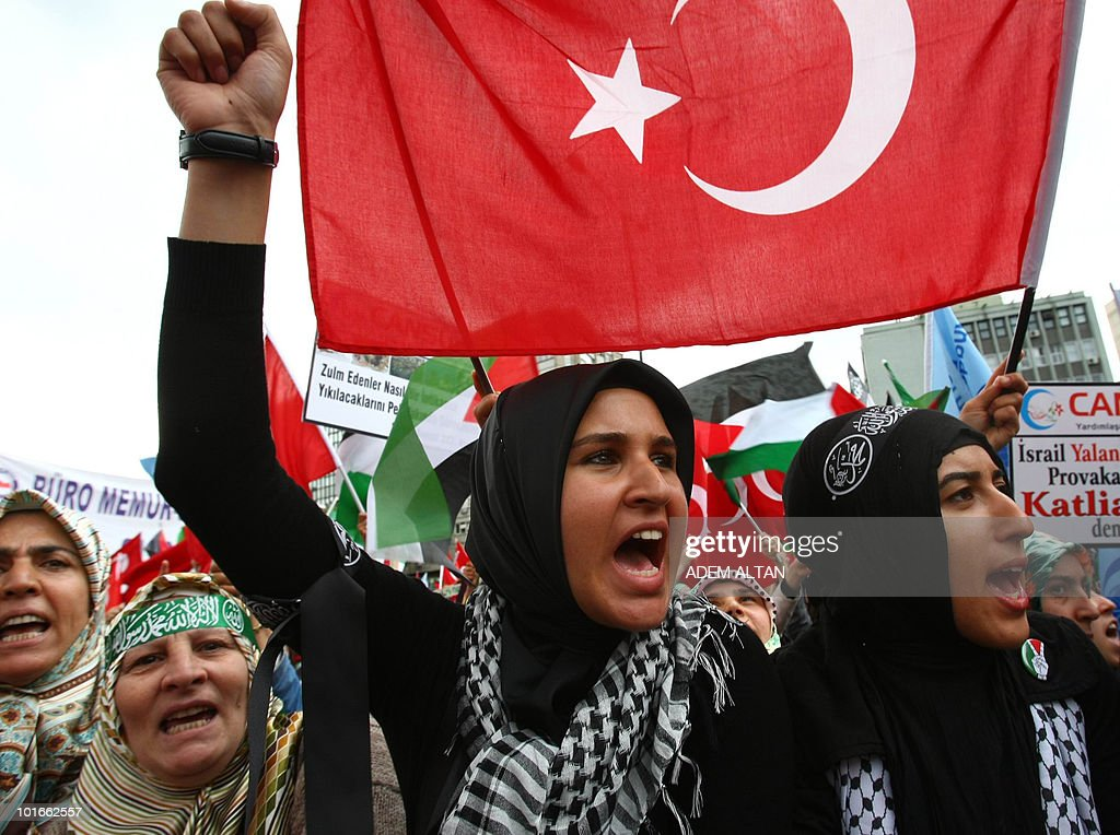 Pro-Palestinian demonstrators wave Turkish and Palestinian flags during a protest in Ankara on June 6, 2010 against Israel's deadly raid on Gaza-bound aid ship. Turkey's Prime Minister Recep Tayyip Erdogan vowed to hold Israel to account over its 'state terror' in the Middle East as thousands held fresh protests against the Israeli operation, in which nine Turks were killed. Some 6,000 to 7,000 people gathered under pouring rain in a central square, shouting 'Damn Israel! Murderer Israel, get out of the Middle East!', an AFP photographer said.