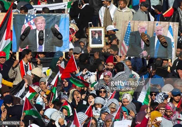 ProPalestinian protesters wave Palestinian and Moroccan flags next to poster of Donald Trump covered in shoes in a sign of disrespect during a...