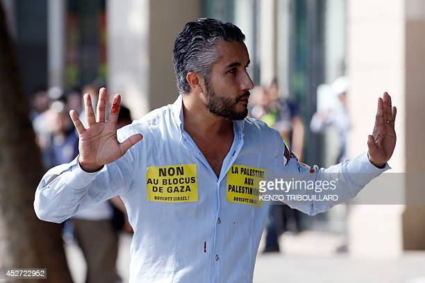 A proPalestinian supporter raises his hand on the Republique square in Paris during a banned demonstration against Israel's military operation in...