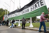 ProPalestinian supporters position a giant banner calling for a recognised Palestinian State in Parliament Square central London on October 13 2014...