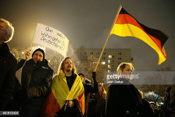 ProPegida activists who in Berlin call themselves 'Baergida' hold up German flags as they demonstrate against the Islamization of Germany and other...
