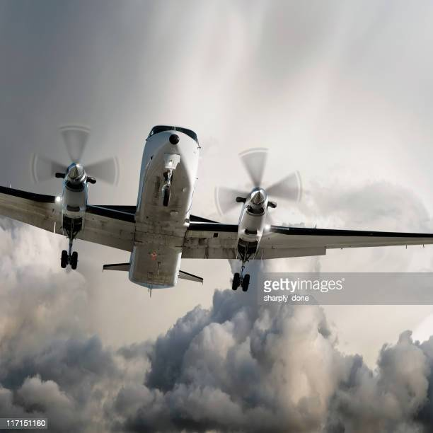 propeller airplane landing in storm