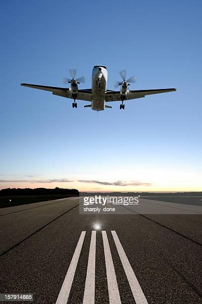 XXXL propeller airplane landing