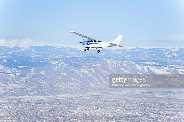Propeller Airplane with Mountains