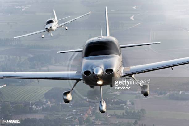 propeller modern airplanes flying in formation