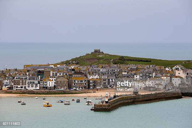 Properties are built around the harbour are seen in the popular seaside resort of St Ives on April 13 2016 in Cornwall England Due to the pressures...