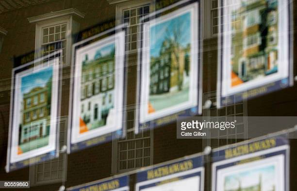 Properties are displayed in the window of an estate agent on April 8 2008 in London England The Halifax has announced that house prices fell in March...