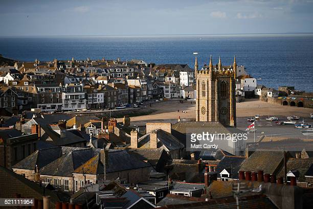 Properties are seen in the popular seaside resort of St Ives on April 13 2016 in Cornwall England Due to the pressures that second and holiday homes...