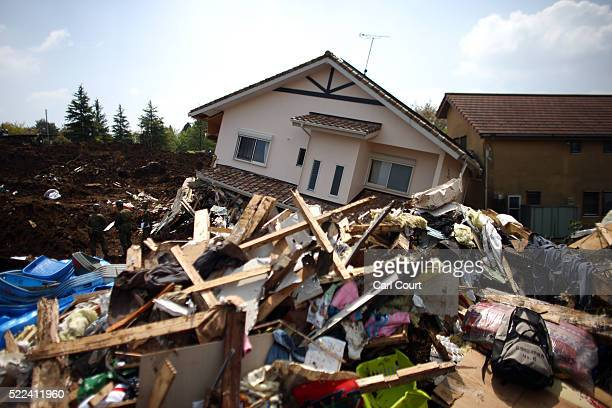 Properties lie destroyed by a landslide following an earthquake on April 19 2016 in Minamiaso near Kumamoto Japan As of April 19 45 people were...