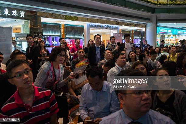 Property agents wait for the draw lots results in front of the television on May 31 2017 in Hong Kong Hong Kong Hong Kong is marking 20 years since...