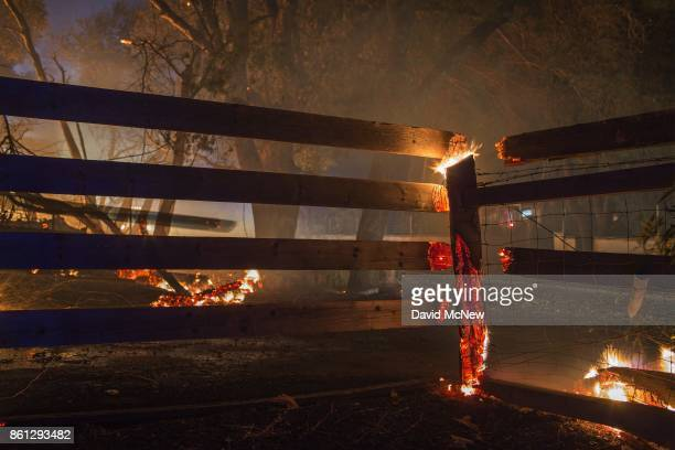 Property burns in the early morning hours on October 14 2017 in Sonoma California At least 32 people are confirmed dead with hundreds still missing...