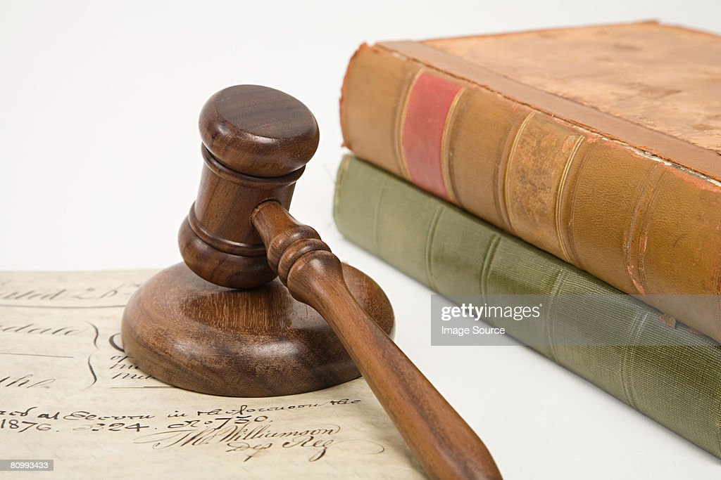 A property document books and a gavel : Stock Photo