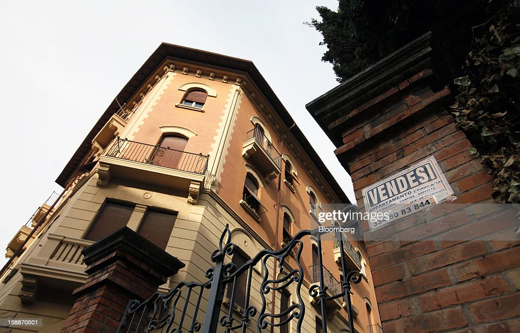 A property for sale sign sits on a wall near residential apartments in the Parioli district of Rome, Italy, on Wednesday, Jan. 2, 2013. Italian property sales often are reported to be less than the actual price paid to reduce taxes or skirt controls on money laundering, according to the website of the finance police, which reports to Italian Finance Minister Vittorio Grilli. Photographer: Alessia Pierdomenico/Bloomberg via Getty Images