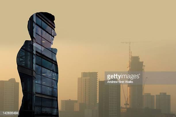 Property investor against commercial skyline