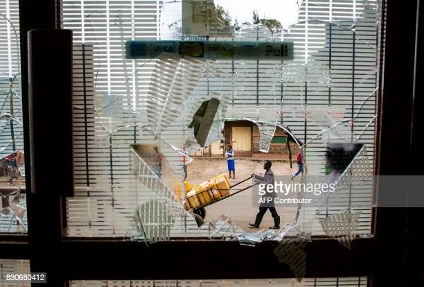 TOPSHOT Property is seen damaged in Kibera slum after protests in Nairobi on August 12 2017 Immediately after news broke that President Uhuru...