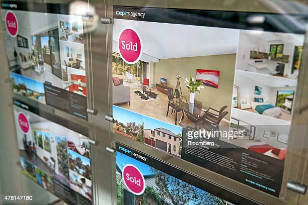 Property listings marked as sold are displayed in the window of Coopers Agency property agents in the suburb of Balmain in Sydney Australia on...