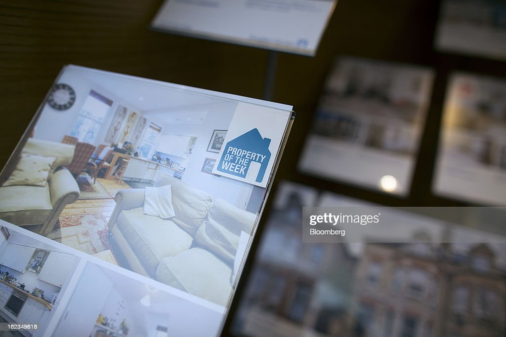 A 'Property Of The Week' logo sits on an information sheet advertising a home in the window of an estate agent in the Putney district of London, U.K., on Friday, Feb. 22, 2013. U.K. home sellers raised their asking prices to the most for a February in five years as inquiries from potential buyers increased, Rightmove Plc said. Photographer: Simon Dawson/Bloomberg via Getty Images