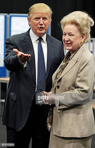 US property tycoon Donald Trump is pictured with his sister Maryanne Trump Barry as they adjourn for lunch during a public inquiry over his plans to...