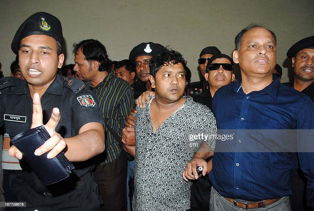 Property tycoon Sohel Rana (C) is presented at a press conference at the Rapic Action Battalion (RAB) headquarters in Dhaka on April 28, 2013. Bangladesh police on Sunday arrested the owner of a garment factory block that collapsed last week killing more than 375 people as hopes faded for survivors at the disaster site.
