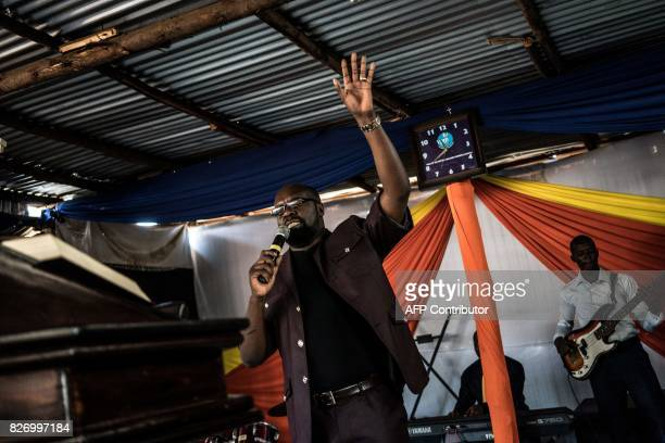 Prophet Lucas Mutishiby leads a service at the Voice of the Potter's Messenger Church on August 6 2017 located at the entrance to Obunga slum in...