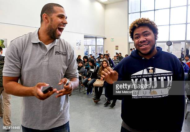 Prophet Walker left a candidate for state Assembly from the Carson/Compton area shares an upbeat moment with Jonathan Chase Butler after speaking to...
