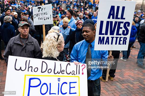 Propolice supporters Debbie Darling and Demetrius Brown have a conversation during a rally in Public Square December 27 in Cleveland Ohio...