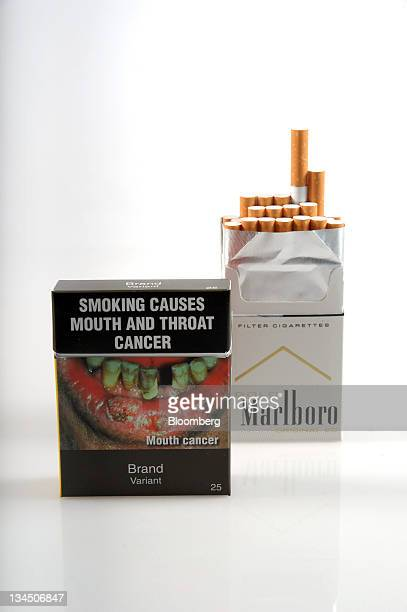 A proposed cigarette packet to be introduced under Australia's cigarette plainpackaging law is arranged with a Philip Morris International Inc...