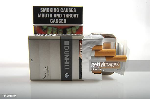 A proposed cigarette packet to be introduced under Australia's cigarette plainpackaging law is arranged with a British American Tobacco Plc Dunhill...