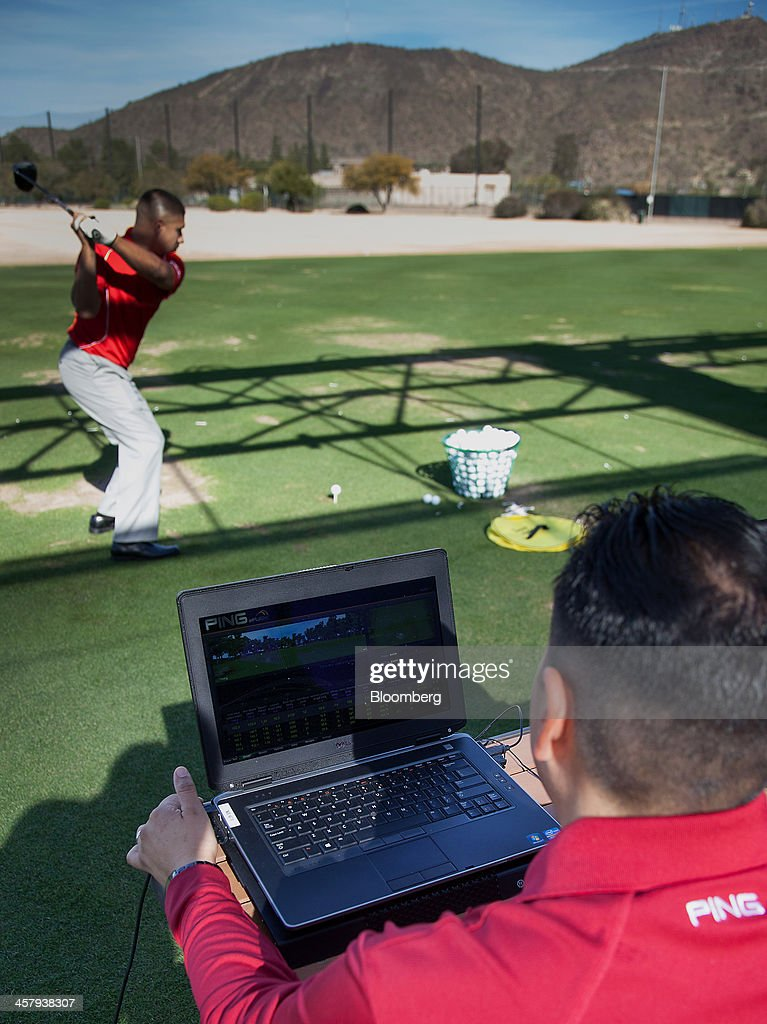 Proprietary software measures a golfers swing at the Ping Inc. testing drive in Phoenix, Arizona, U.S., on Tuesday, Dec. 17, 2013. The U.S. Census Bureau is scheduled to release durable goods figures on Dec. 24, 2013. Photographer: Tim Rue/Bloomberg via Getty Images