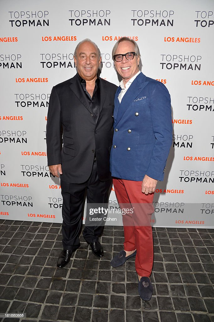 Proprieter Sir Philip Green (L) and fashion designer Tommy Hilfiger arrive at the Topshop Topman LA Opening Party at Cecconi's West Hollywood on February 13, 2013 in Los Angeles, California.